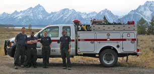 Photo of interagency engine crew with Tetons in background