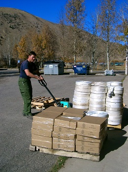 Image of hose and boxes being taken off a pallet