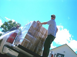 Image showing supplies being loaded onto a truck